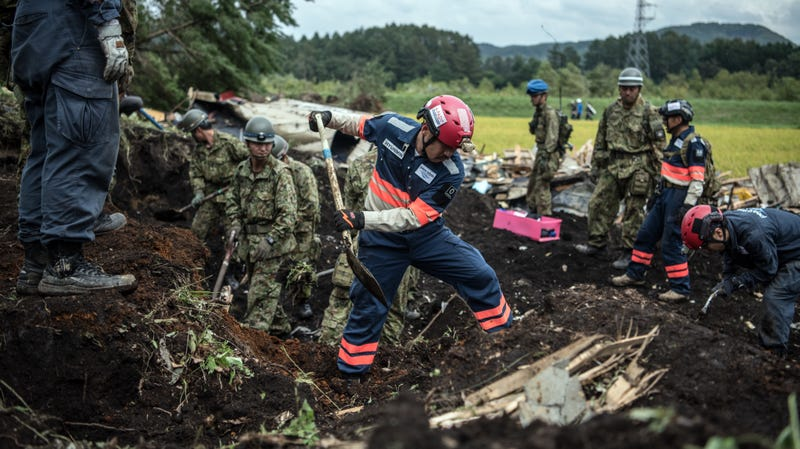 Rescuers search through debris in the recent Hokkaido earthquake.