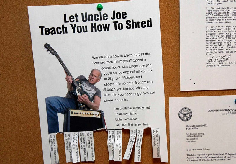 Illustration for article titled Biden Pins Up Guitar Lesson Flyers On White House Bulletin Board