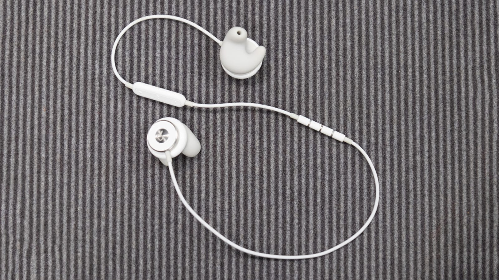 earbuds around ear