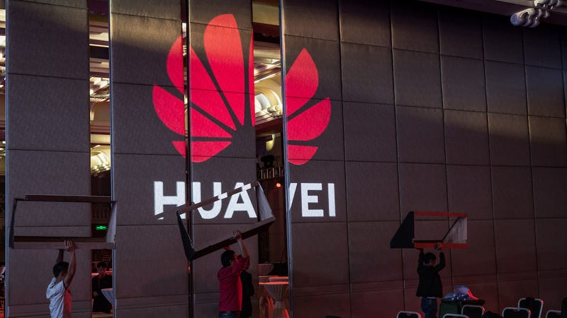 Workers prepare the venue for Huawei HAS2019 Global Analyst Summit on April 16, 2019 in Shenzhen, China.