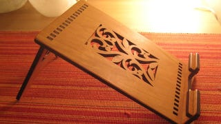Illustration for article titled Boost Your iPad's Ego With This Laser Cut Cherry Wood Stand