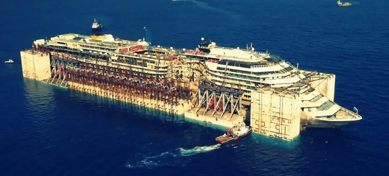 Illustration for article titled Drone films the eerie Costa Concordia sailing on its last voyage