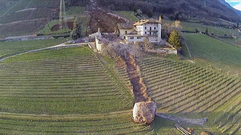 Illustration for article titled Giant boulder destroys building in Italy, another one misses by inches