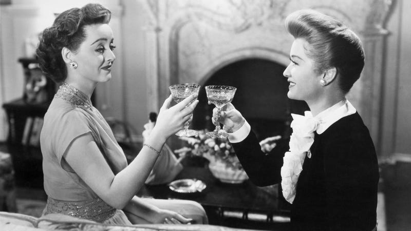 We (almost) did it! (Bette Davis and Miriam Hopkins toasting in 1943's Old Acquaintance [Photo: Bettmann/Contributor/Getty])