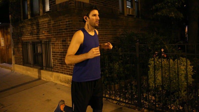 A guy running at 9 P.M.