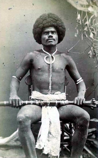 Pictured holding a rootstock club and wearing a boar's tusk necklace is Fijian mountain warrior Kai Colo, 1870s. Fiji is part of Melanesia, a region from which many West Indians can trace some of their heritage.Wikimedia Commons