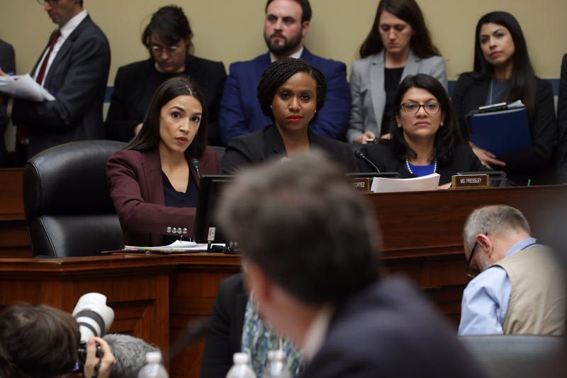 Rep. Alexandria Ocasio-Cortez (D-N.Y.), Rep. Ayanna Pressley (D-Mass.) and Rep. Rashida Tlaib (D-Mich.) listen as Michael Cohen, former attorney and fixer for President Donald Trump, testifies before the House Oversight Committee on Capitol Hill Feb. 27, 2019, in Washington, D.C.