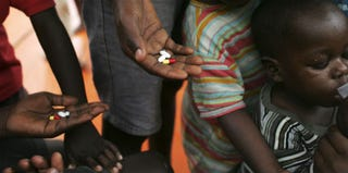 HIV-positive orphans take anti-retroviral drugs at a clinic in Uganda. (Marco Di Lauro/Getty Images)