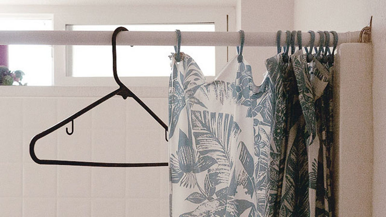 Make Hangers And Shower Curtains Glide With Wax Paper