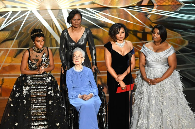NASA mathematician Katherine Johnson (seated) appears onstage with actresses Janelle Monáe (left), Taraji P. Henson (second from right) and Octavia Spencer (right) during the 89th Annual Academy Awards at Hollywood & Highland Center on Feb. 26, 2017, in Hollywood, Calif.