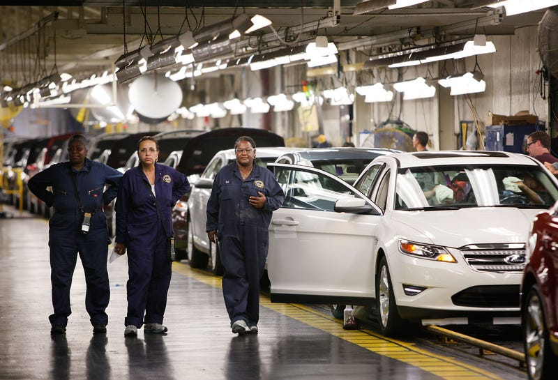 Workers walk the assembly line at Ford's Chicago Assembly Plant on Aug. 4, 2009. The Chicago plant was the subject of a New York Times exposé into systemic racial and sexual abuse suffered by Ford's female workers. (Scott Olson/Getty Images)
