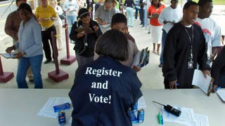 A Board of Elections official hands out absentee ballots during early voting in Savannah, Ga., Oct. 23, 2008.Stephen Morton/Getty Images