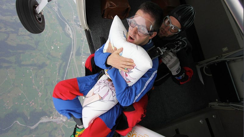 Illustration for article titled Pure Nerd Insanity: Two Men Skydiving with a Girly Hug Pillow