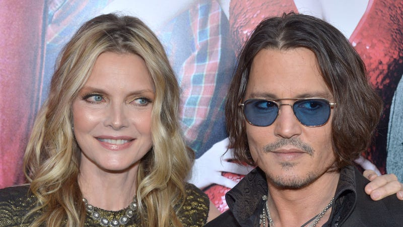 Illustration for article titled Johnny Depp and Michelle Pfeiffer Have Perfected the Art of the Side-Eye