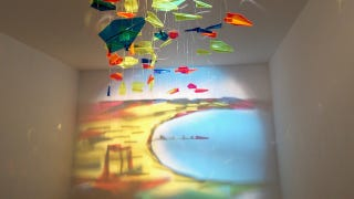 Illustration for article titled This Painting Is Made Using Light and Plexiglass Airplanes