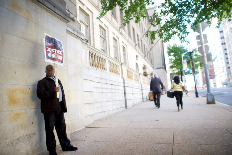 Arthur B. Johnson demonstrates outside Circuit Court on the first day in the trial of Baltimore Police Officer Caesar Goodson Jr. on June 9, 2016, in Baltimore.Mark Makela/Getty Images