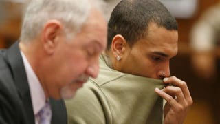 Chris Brown (right) attends a progress hearing at Los Angeles Superior Court Jan. 15, 2015. Brown was first placed on probation after a 2009 domestic violence case in which he pleaded guilty to assaulting his then-girlfriend, singer Rihanna.Lucy Nicholson/Pool/Getty Images