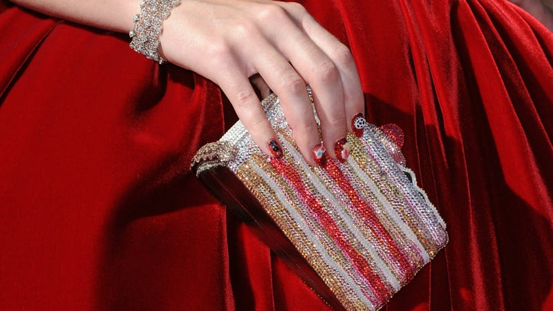 Katy Perry carries a Judith Leiber bag shaped like a slice of cake, 2012.