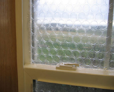 Illustration for article titled Hang Bubble Wrap as Temporary Curtains