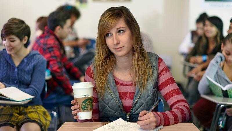 Morgan drinking coffee in class.
