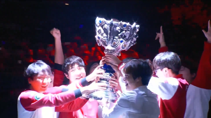 SK Telecom T1 lift the Summoner's Cup after winning Worlds 2016.