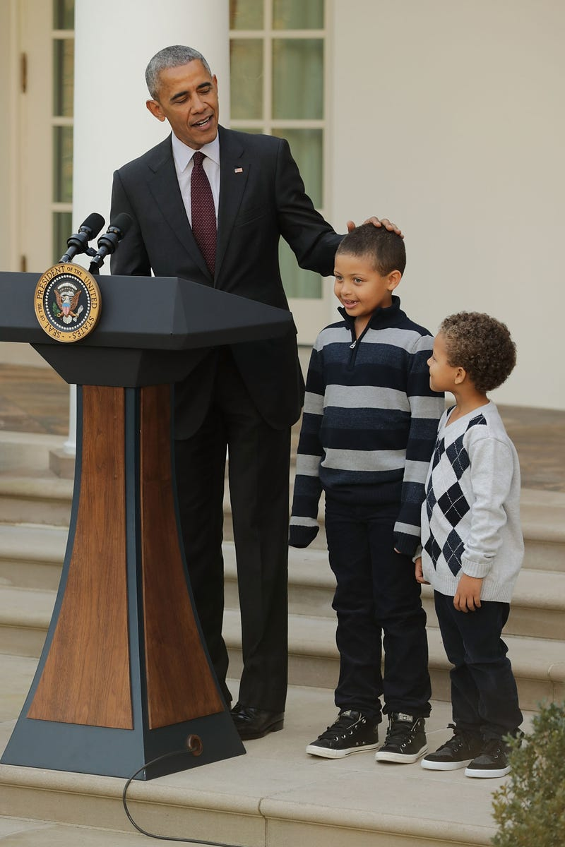 President Barack Obama, here with his nephews Aaron and Austin Robinson,  delivers a speech filled with puns before pardoning the National Thanksgiving Turkey during a ceremony in the Rose Garden at the White House in Washington, D.C., on  Nov. 23, 2016.  Chip Somodevilla/Getty Images