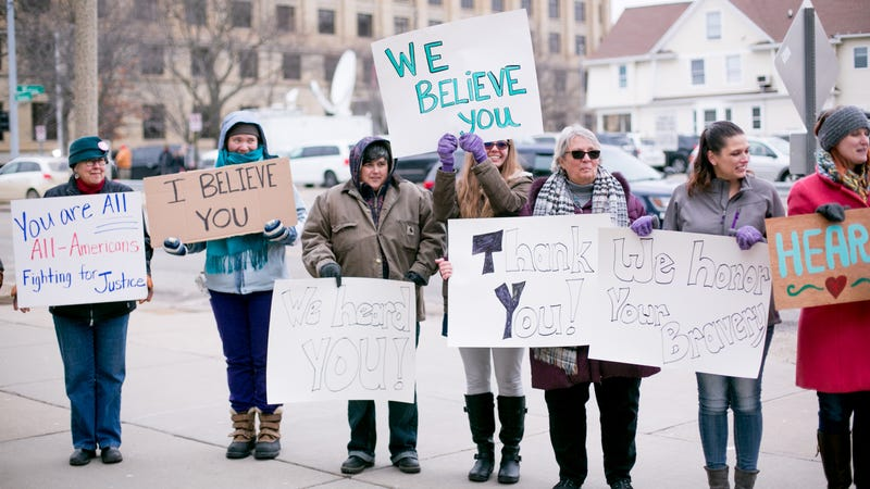 Women from Michigan based victim advocacy groups  cheer for women as they leave the courthouse after the sentencing of  Larry Nassar. Photo: Getty Images.