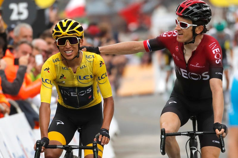 Britain's Geraint Thomas, right, congratulates Colombia's Egan Bernal wearing the overall leader's yellow jersey as they crosses the finish line of the twentieth stage of the Tour de France.