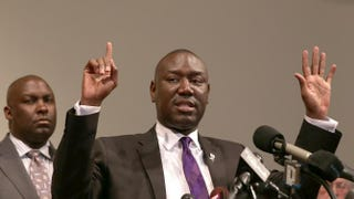 Benjamin Crump, the lawyer for Michael Brown's family, indicates with six fingers the number of times Brown was struck by bullets from Officer Darren Wilson's gun Aug. 9. Crump was speaking at a news conference at the Greater St. Marks Family Church on Aug. 18, 2014, in Ferguson, Mo.Joe Raedle/Getty Images