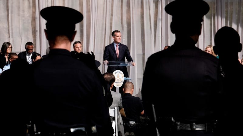 LAPD officers watch as Los Angeles Mayor Eric Garcetti swears in veteran Michel Moore as the new chief of police in July 2018.