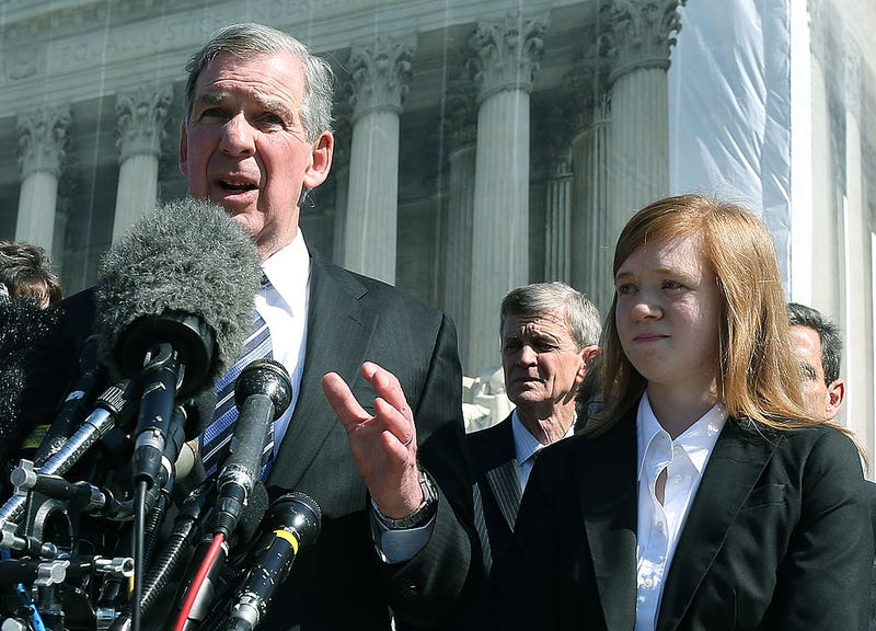 Attorney Bert Rein with plaintiff Abigail Noel Fisher after the U.S. Supreme Court heard arguments in her case Fisher v. University of Texas at Austin on Oct. 10, 2012, in Washington, D.C. (Mark Wilson/Getty Images)
