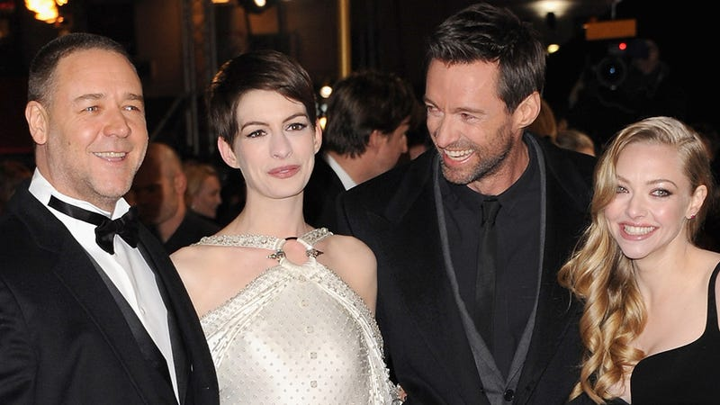 Illustration for article titled Anne Hathaway's Dress Was as Ridiculous as a Castle on a Cloud at the Les Mis Premiere