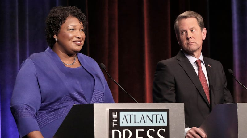 Georgia gubernatorial candidates (L-R) Democrat Stacey Abrams and Republican Brian Kemp debate in an event that also included Libertarian Ted Metz at Georgia Public Broadcasting in Midtown October 23, 2018 in Atlanta, Georgia.