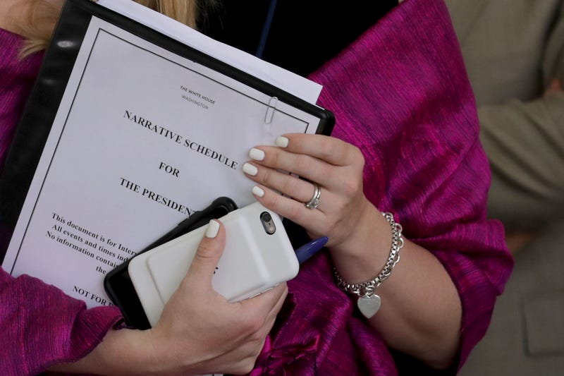 A White House employee holds a copy of the 'Narrative Schedule For The President' before President Donald Trump announces his decision to pull out of the Paris climate agreement at the White House June 1, 2017 in Washington, DC.