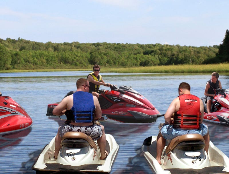 Illustration for article titled Leader Of Sea-Doo Riders Holds Court In Middle Of Lake