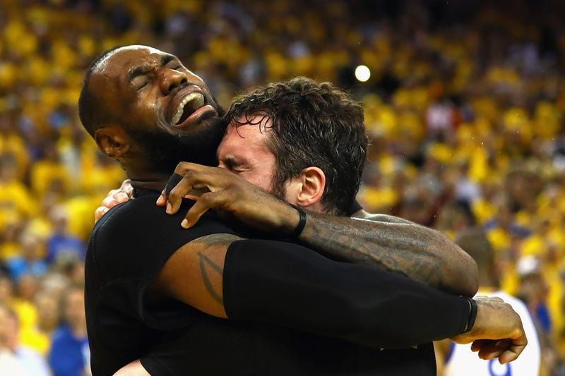 LeBron James and Kevin Love of the Cleveland Cavaliers celebrate after defeating the Golden State Warriors 93-89 in Game 7 of the 2016 NBA Finals June 19, 2016, in Oakland, Calif.Ezra Shaw/Getty Images