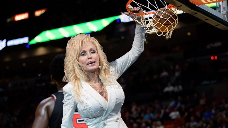 Illustration for article titled 5 Pictures Of Dolly Parton Dunking That You Can't Find Anywhere Else...Because They're Fake, Okay?! They Aren't Real! We Made Them In Photoshop So You Would Like Us
