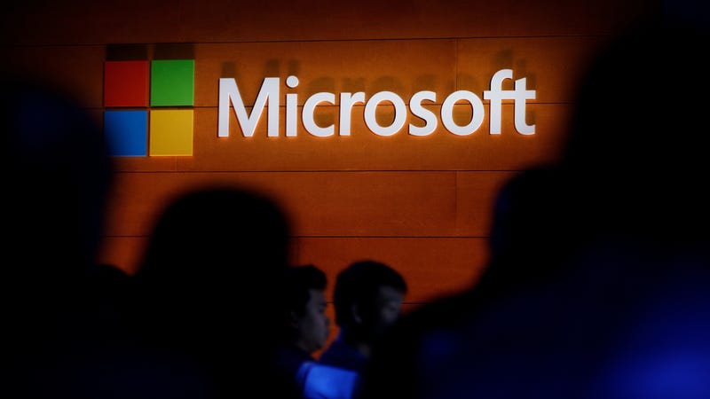 The Microsoft logo is illuminated on a wall during a Microsoft launch event to introduce the new Microsoft Surface laptop and Windows 10 S operating system, May 2, 2017 in New York City.