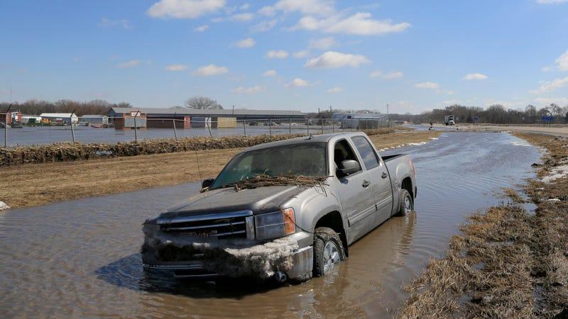 A pickup truck swept aside by flood waters in Norfolk, Nebraska on March 15, 2019