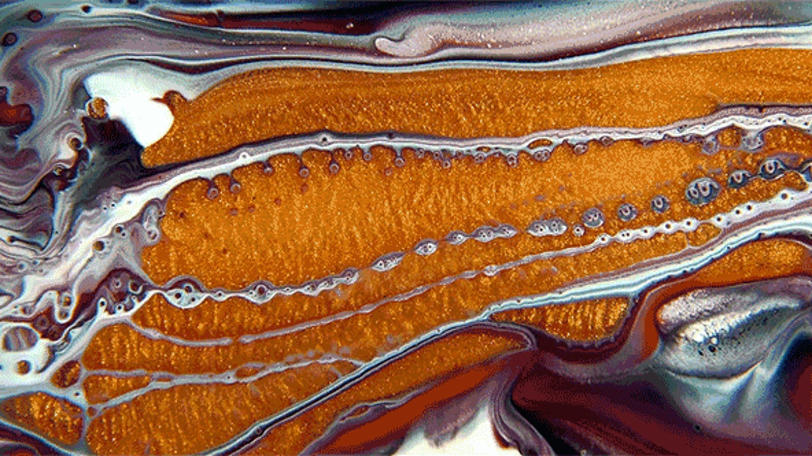 Mixing Oil, Paint, and Soap Looks Like Flying Over a Distant Alien World