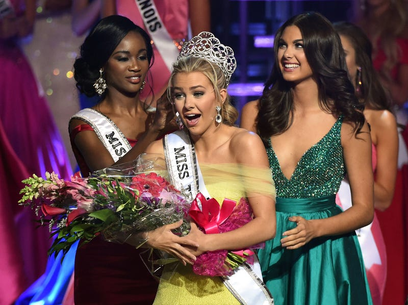 Miss Texas Teen USA 2016 Karlie Hay (center) reacts as Miss USA 2016 Deshauna Barber (left) and Miss Teen USA 2015 Katherine Haik (right) crown Hay as Miss Teen USA 2016 during the Miss Teen USA competition in Las Vegas on July 30, 2016.  Ethan Miller/Getty Images