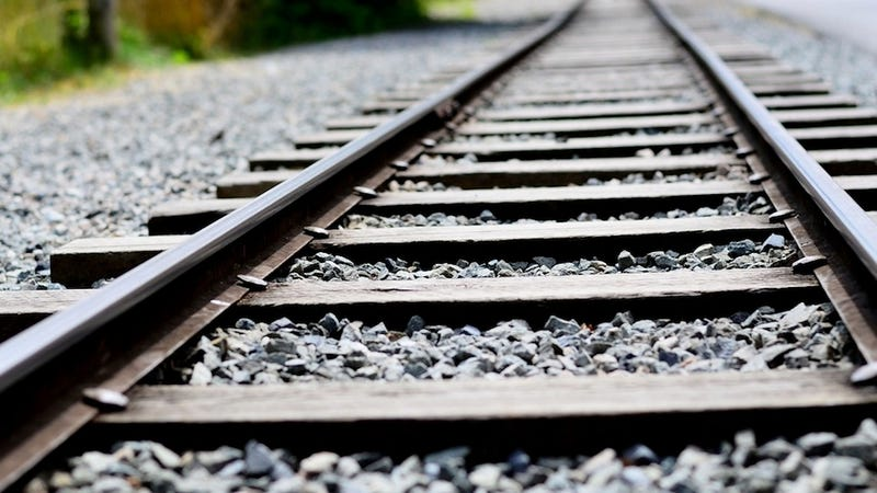 the crushed stones you see alongside railroad tracks are what is known as ballast their purpose is to hold the wooden cross ties in place which in turn