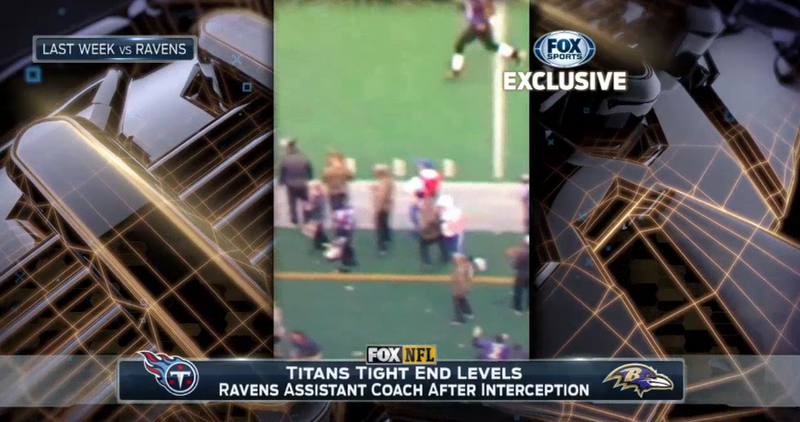 Illustration for article titled Titans Tight End Takes Out Ravens Assistant Coach On Sideline