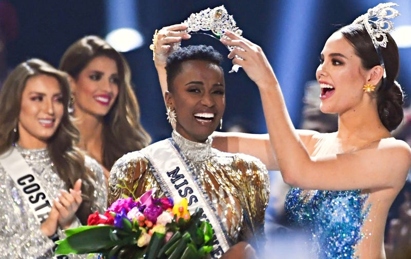 Miss Universe 2018 Philippines' Catriona Gray crowns the new Miss Universe, South Africa's Zozibini Tunzi, during the 2019 Miss Universe pageant at Tyler Perry Studios in Atlanta on Dec. 8, 2019.
