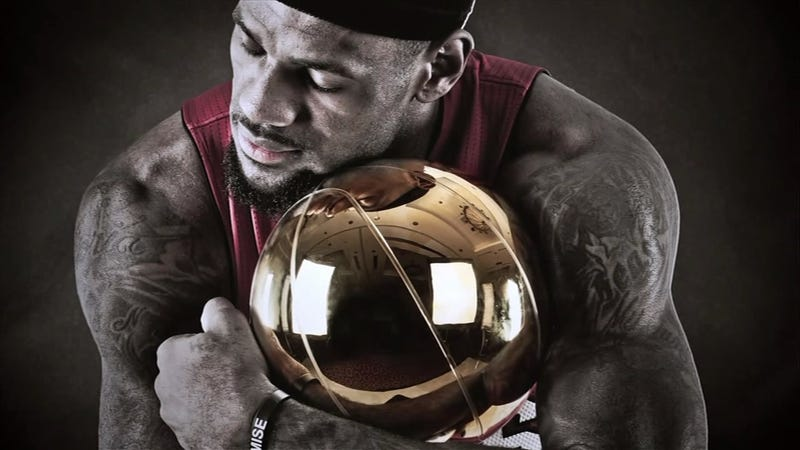 Illustration for article titled LeBron James Cuddled The Larry O'Brien Trophy Like It Was One Of His Children