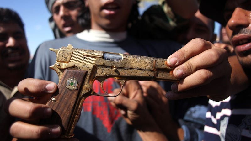 Illustration for article titled Qaddafi Died Packing a Giant Golden Gun