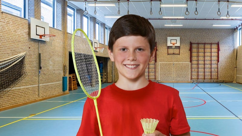 A kid holding a badminton racket