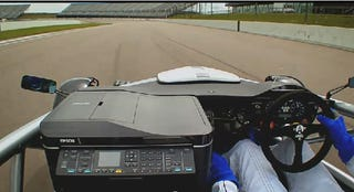 Illustration for article titled Race Car Races Inkjet Printer Around Track