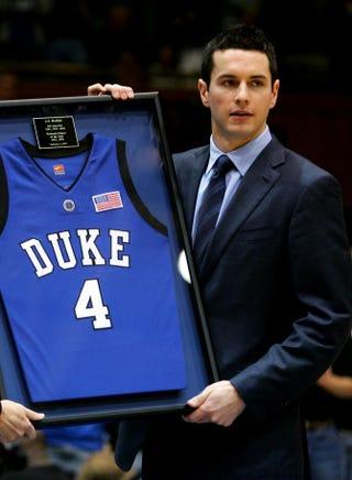 14f85fd08306 Former Duke University Blue Devil J.J. Reddick holds his jersey after it  was retired during halftime