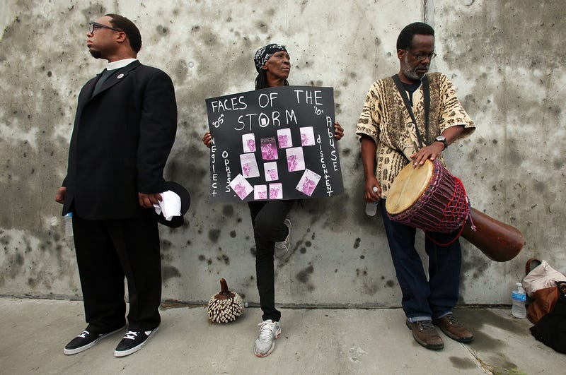 Mourners at an Aug. 2010 healing ceremony at the site of theLower Ninth Ward levee breach. (Mario Tama/Getty Images)